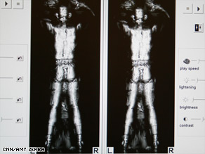 The whole-body imaging machine scans for objects and liquids on passengers.
