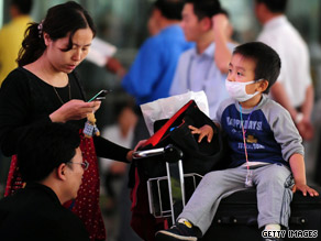 A child traveling with his parents wears a face mask after they arrive at the Beijing, China, airport.
