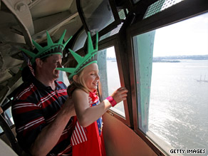 Tourists head into the Statue of Liberty on Saturday.