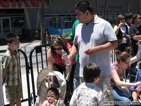 The Alvarez family waits in line to write on Michael Jackson's memorial wall on Monday.