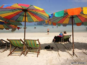 Tourists enjoy the beach on Phi Phi Island, Thailand.