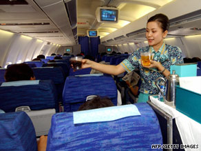 The job was once considered glamorous. Here, a flight attendant serves champagne aboard a jumbo jet in 1970.