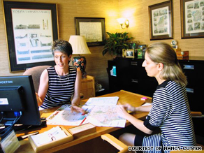 Nancy Cutter, a travel agent in Charlotte, North Carolina, discusses vacation options with a client.