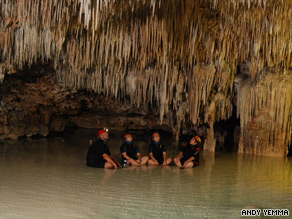 Stalactites hang overhead in a cave along Mexico's Riviera Maya.