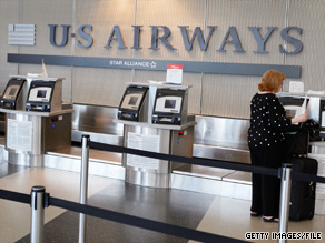 A US Airways passenger's first checked bag will cost $20 if prepaid online.