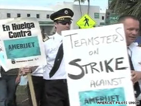 A striking AmeriJet pilot, shown in a YouTube video, holds up one of the waste bags on a picket line