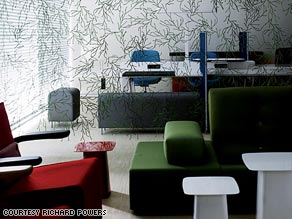 """In the lobby of Amsterdam's citizenM, a plastic """"algae"""" curtain separates the computer station from the sitting area."""