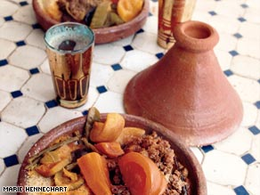 The Traiteur Marocain stall at the Marche des Enfants Rouges offers traditional Moroccan couscous dishes.