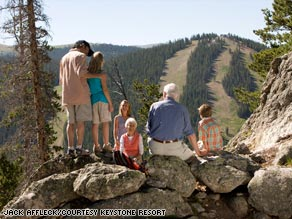 A family takes a break on a hike at Keystone Resort in Colorado.