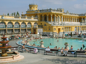 Locals in Budapest love to soak in their hot springs while playing chess.
