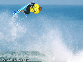 Surfing champ Kelly Slater gains altitude at Hossegor, France, in 2002.