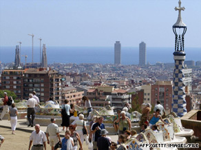 People gather in Barcelona, Spain's Park Guell, a garden with architectural designs by Antoni Gaudi.