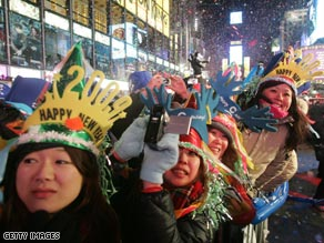 Revelers in New York braved freezing conditions and snow to see in the New Year.