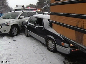 Cars and buses are crunched together after a major pileup on Interstate 93 on Sunday.