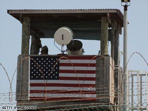 A guard keeps watch from a tower at the military facility at Guantanamo Bay, Cuba.