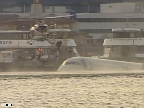 Rescuers carry passengers ashore from a US Airways flight that ditched in the Hudson River on Thursday afternoon.