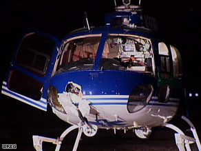 The bird hangs from a hole in the helicopter's nose after the landing.