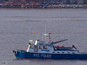 A New York Police boat in the Hudson waters Wednesday where divers found one of the plane's engines.