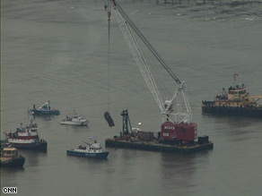 A jet engine lost after Flight 1549 ditched in the Hudson River is hoisted from the water Friday.