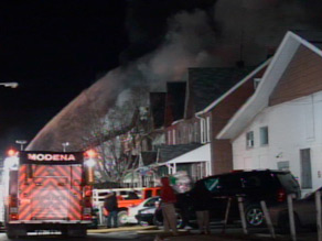 A huge fire spread through more than a dozen homes Sunday outside Philadelphia, authorities said.