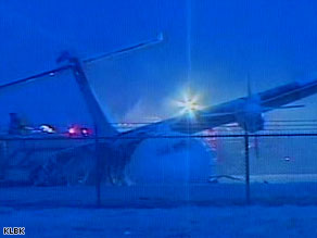 A damaged FedEx ATR-42 lies beside a runway early Tuesday at the Lubbock, Texas, airport.