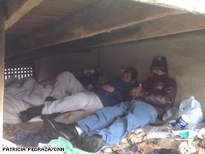 The men's under-porch shelter was just feet from a street in Plainfield, New Jersey.