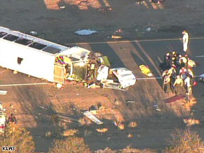 Authorities work on the crash scene Friday on U.S. 93 in White Hills, Arizona, near Hoover Dam.