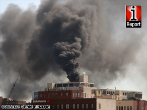 Smoke rises from Spectrum Health Butterworth Hospital in Grand Rapids, Michigan, after a helicopter crash in May.