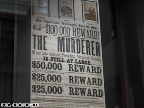 "An original ""wanted"" poster reads: ""$100,000 Reward. The murderer is still at large."""