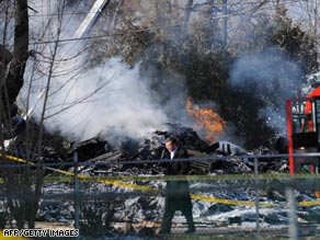An investigator works the scene of the plane crash Friday outside Buffalo, New York.