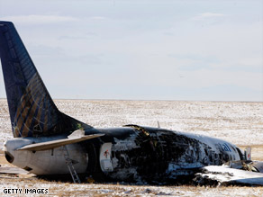 The wreckage of a Continental Airlines 737 sits off a runway at Denver International Airport in December.