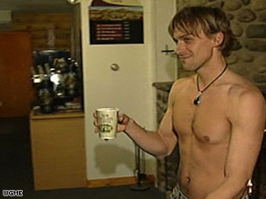 Male and female servers go topless at Grand View Topless Coffee Shop.
