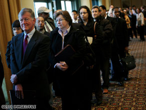 Job seekers wait in line for a job fair at a hotel last month in Melville, New York.