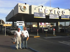 Edward Chrisman, left, crosses the Mexican border back into the United States after being freed Saturday.