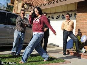Nadya Suleman walks outside her new house for a video crew in La Habra, California, on March 10.