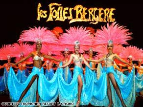 Las Vegas showgirls strut their stuff in Les Folies Bergere, which is closing after 50 years.