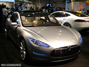 Tesla unveils its Model S sedan, with a base price of $57,400. The manufacturing plant will be in California.