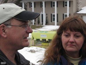 The couple says they believe their home was sacrificed to save the rest of their neighborhood.