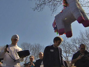 "A pinata is about to be smashed at the ""Unemployment Olympics"" in New York City on Tuesday."