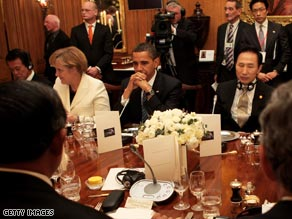 President Obama is discussing the global economic crisis with other world leaders at the G-20 summit this week.