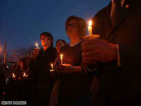People take part in a candlelight vigil this week for victims of the Binghamton, New York, shooting rampage.