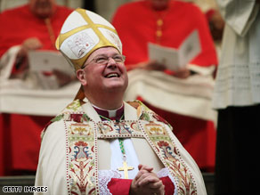 Archbishop Timothy Dolan looks to the sky during an evening prayer service Tuesday in New York.