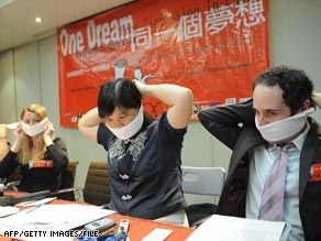 Media freedom campaigners don gags during a news conference in Hong Kong in April 2008.