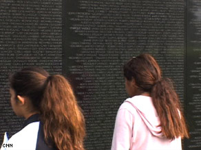Visitors scan the names on the Vietnam Veterans Memorial in Washington.
