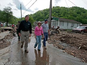 West Virginia Gov. Joe Manchin tours Mingo County to assess damage caused by extensive rain and flooding.