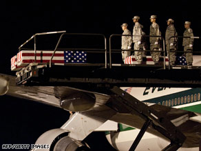 The body of one of the servicemen shot dead by a fellow soldier in Iraq arrives at Dover Air Force Base.