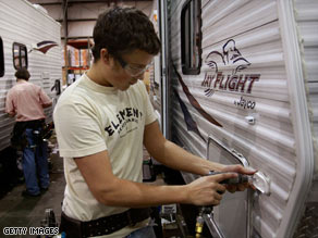 Workers at the Jayco plant in Elkhart County in Indiana put together a travel trailer in February.
