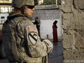 A soldier with the U.S. Army's 1st Cavalry Division patrols the streets of eastern Mosul, Iraq, on June 16.