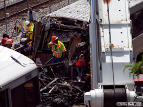 Emergency personnel investigate the scene of the Metro train crash in Washington on Monday.