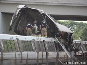 Firefighters climb atop the wreckage of two Metro subway trains that collided Monday in Washington.